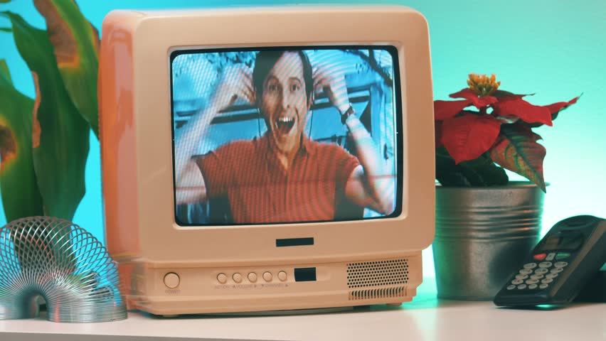 MONTREAL, CANADA - February 2019 : Vintage Sony Walkman commercial playing on TV 80's 90's style. Retro looking desk and setup with old television CRT monitor.