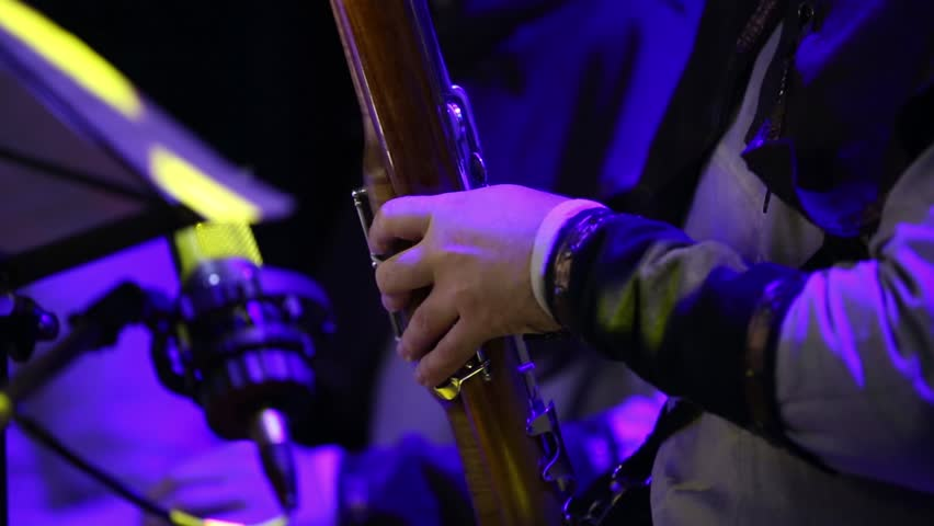 A man plays the bassoon Close up