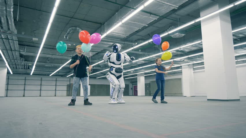 Two kids with balloons are walking with a robot | Shutterstock HD Video #1024036931