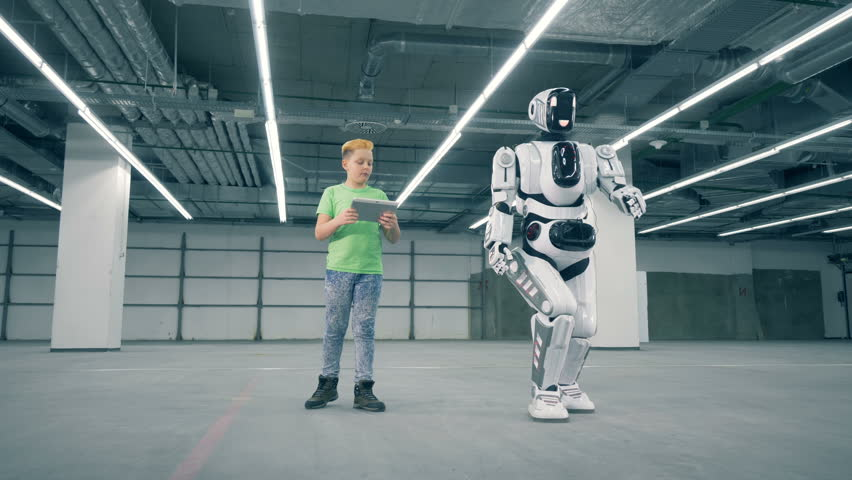 Child is navigating a moving droid with his computer | Shutterstock HD Video #1024036943