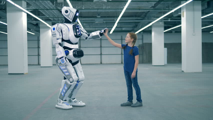 A robot and a girl are touching each other's hands | Shutterstock HD Video #1024036949