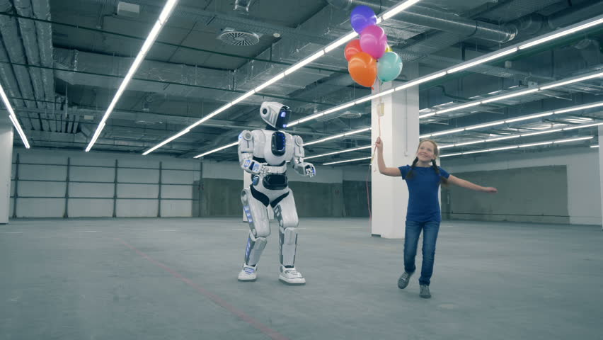 Teenage girl is dancing with balloons and walking with a human-like droid | Shutterstock HD Video #1024036964