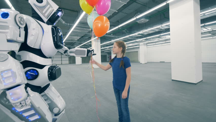Robot gives balloons and its hand to a girl in a storage unit | Shutterstock HD Video #1024036973