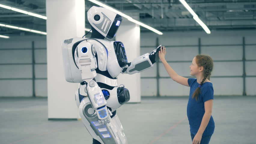 High-five gesture of a little girl and a robotic humanoid | Shutterstock HD Video #1024036976