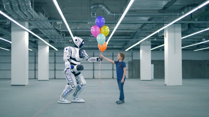 Human-like droid is coming and giving balloons to a girl | Shutterstock HD Video #1024036991