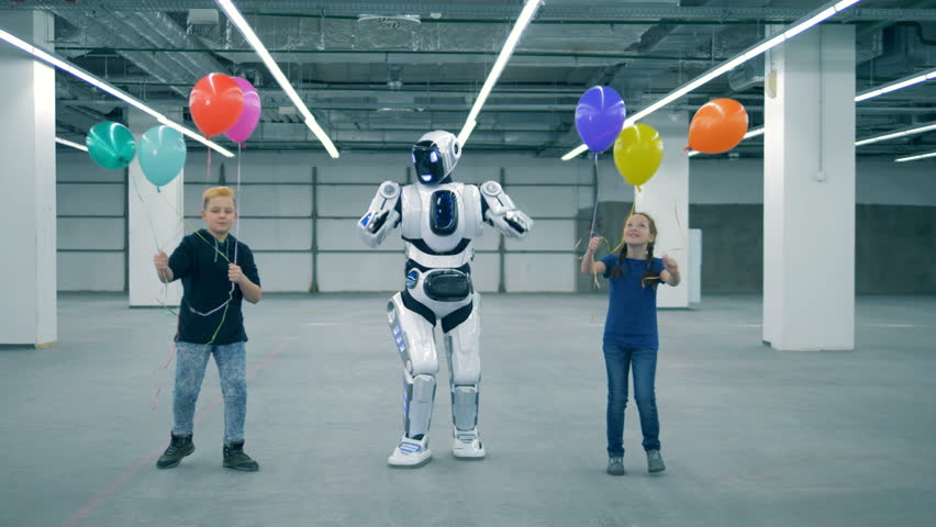 Children with balloons and a droid are dancing happily | Shutterstock HD Video #1024037003