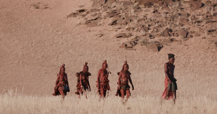 4K view of people from the Himba tribe walking in the Namib Desert,Namibia | Shutterstock HD Video #1024050182
