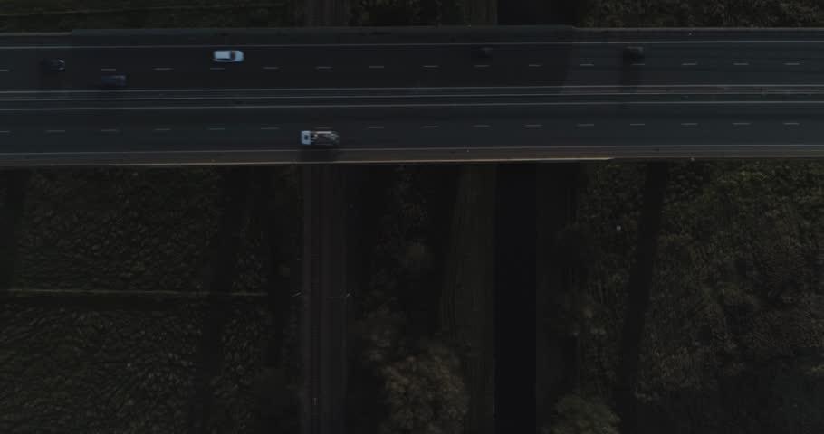 Busy motorway bridge over English countryside   Shutterstock HD Video #1024051679