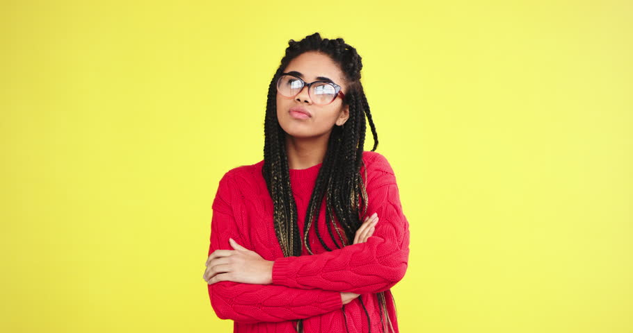 African lady nerd multi ethnic in the studio with a yellow background wall wearing eyeglasses and happy looking to the camera smiling large. 4k | Shutterstock HD Video #1024056059