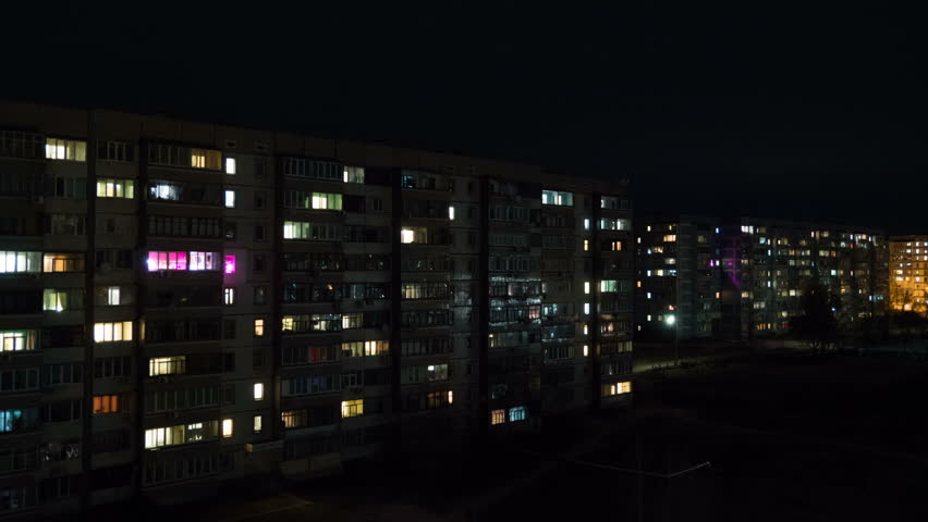 Multi-Storey Building With Changing Window Lighting At Night. High-rise houses, in apartments that light up the windows. Time Lapse | Shutterstock HD Video #1024085855