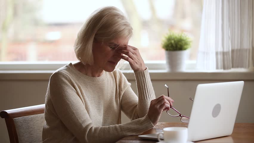 Senior woman using laptop feeling discomfort from dry irritated fatigued eyes taking off glasses, older mature businesswoman tired of computer worker suffering from blurry vision eyestrain problem Royalty-Free Stock Footage #1024093982