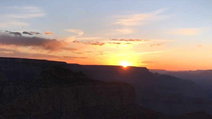 Slow moving clouds and Sunset Time Lapse over the Grand Canyon from Moran Point. | Shutterstock HD Video #1024106615