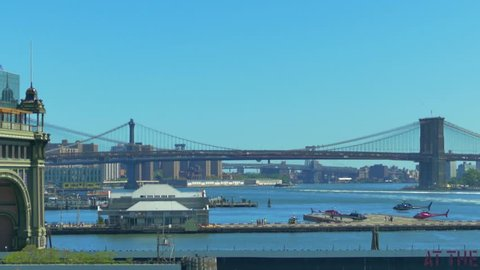 4K (UHD) 25P New Yor City, Lower Manhattan, Ferry - Wider shot of Brooklyn Bridge pass, feeries and helicopters in the background