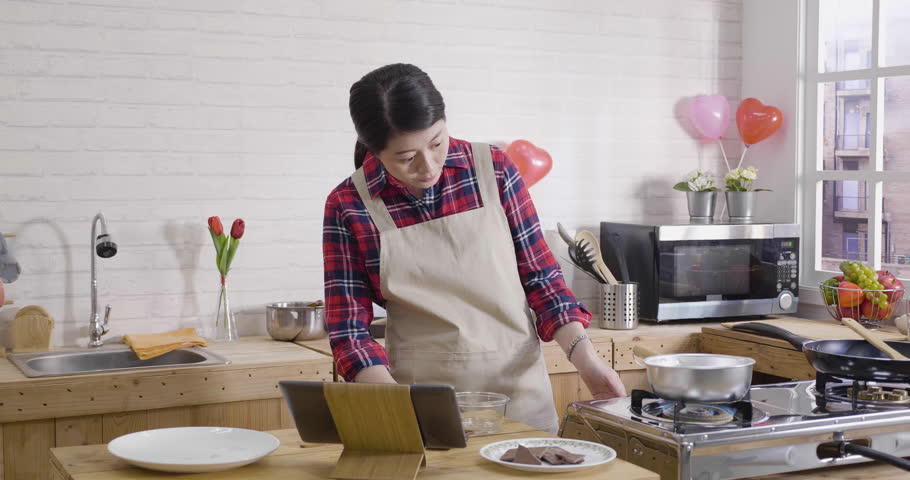 Asian Female Turning On Kitchen Stock Footage Video (100% Royalty-free)  1024124819 | Shutterstock