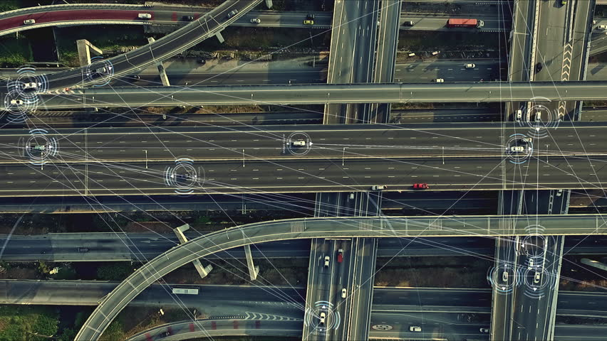 Aerial view from above of traffic on the elevated expressway with futuristic autonomous, driverless cars using artificial intelligence computer network and satellite gps for navigation | Shutterstock HD Video #1024125953