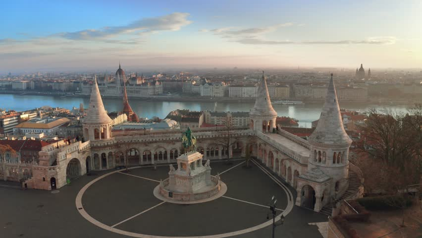 Budapest, Hungary - 4K flying over the famous Fisherman's Bastion towards River Danube with Parliament of Hungary at background | Shutterstock HD Video #1024127963