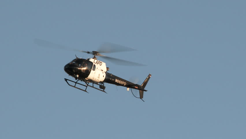 LAPD helicopter flying overhead patrolling the area.