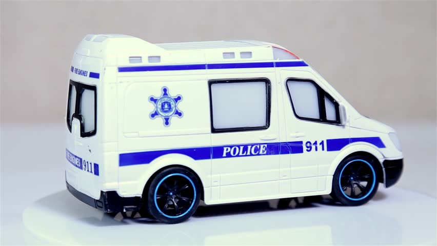 White toy police bus scale model car rotating on white background. | Shutterstock HD Video #1024175594