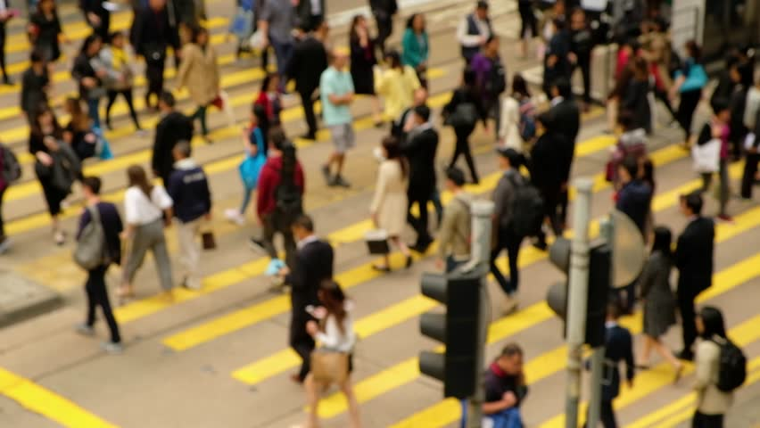 Blurred people on busy crosswalk. Travel busy people concept. Hong Kong concept. Real time. 4K | Shutterstock HD Video #1024189604