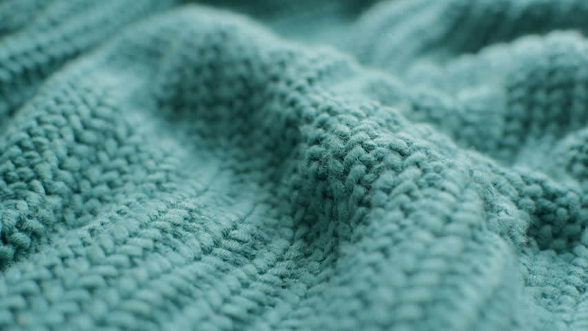 The texture of the fabric. Green knitted texture. Close-up. Can be used as a background. HD Royalty-Free Stock Footage #1024189817
