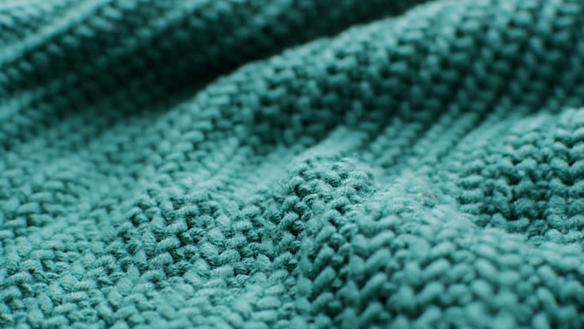 The texture of the fabric. Green knitted texture. Close-up. Can be used as a background. HD Royalty-Free Stock Footage #1024189838
