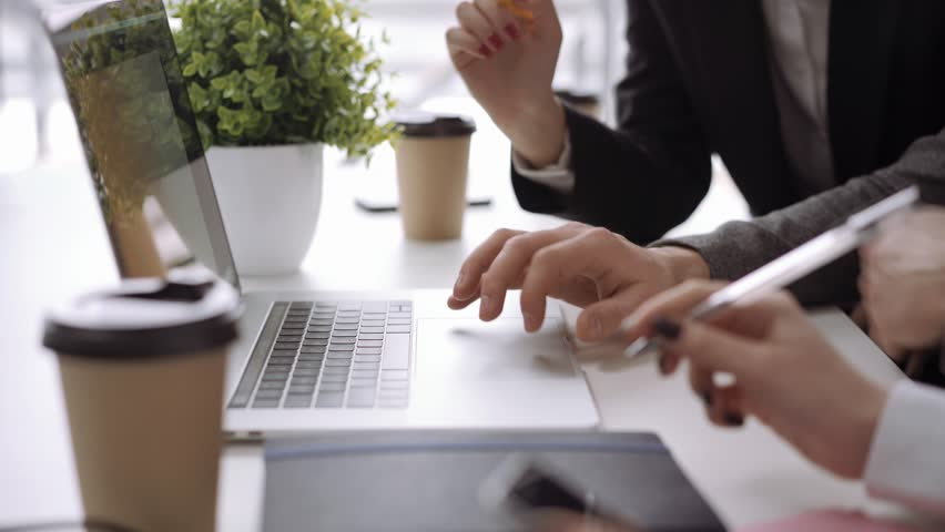 Close up hands. Business team work in office and discussing start up ideas and projects | Shutterstock HD Video #1024231133