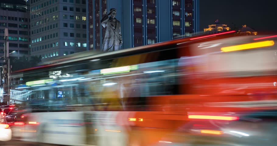 JAKARTA, Indonesia - February 11, 2019: Time lapse footage of traffic jam with crowded vehicles and Sudirman statue background at night on Sudirman street in Jakarta. Shot in 4k resolution | Shutterstock HD Video #1024272065