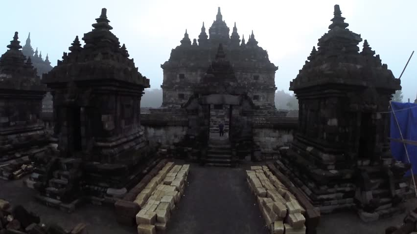 Plaosan Temple, Klaten, Central Java - December 5, 2018 : Taking a video of Plaosan Temple with the dew using drone.   Shutterstock HD Video #1024278743