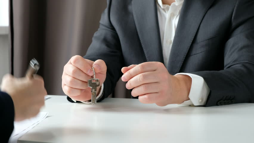 Real estate broker and customer shaking hands after signing a contract: real estate, home loan concept. Close up | Shutterstock HD Video #1024279181
