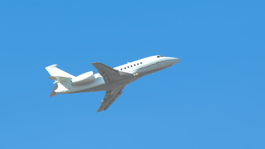 Generic Unmarked Executive Jet Close-up Flying Up into a Clear Blue Sky on a Sunny Day #1024294670