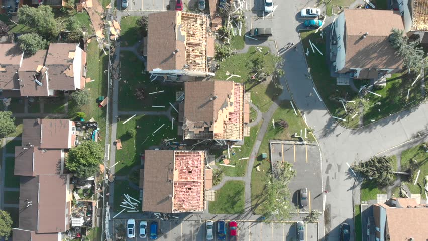 Top-down aerial footage of devastated and roofless homes in Ottawa Ontario after a tornado