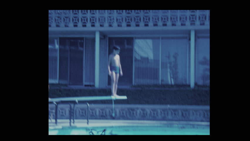 San Francisco, California, USA- 1971: Reluctant boy and brother dive into hotel pool