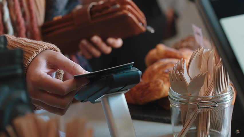 close up customer paying using credit card contactless payment spending money in cafe with digital transaction service Royalty-Free Stock Footage #1024313396