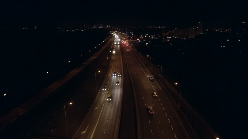 4K. Aerial view of the night highway with a road junction. Warsaw Poland. Drone footage of midnight city roads. Highway cloverleaf interchange intersection with ramps, heavy traffic.   Shutterstock HD Video #1024315859