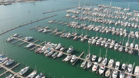 dock full sail boats parallax aerial aerial video parallax blue sea industrial harbour at back
