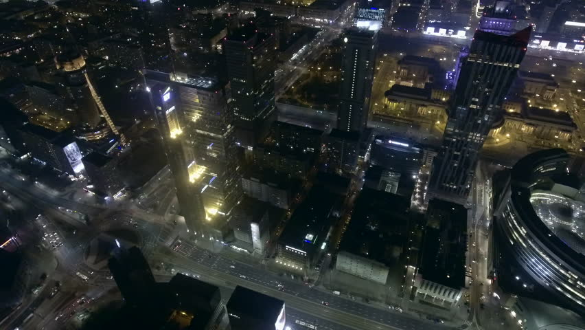 AERIAL VIEW. Spectacular aerial view of skyscraper city buildings at night. 15. February. 2019. The center of the metropolis of Warsaw at night. | Shutterstock HD Video #1024346975