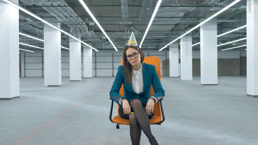 Tired office lady is sitting in a chair in an empty hall | Shutterstock HD Video #1024350701