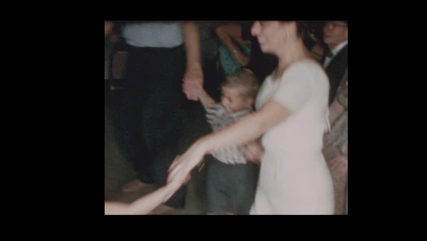 Baltimore, Maryland, USA- 1958: Jewish Children dance Hora Nirkoda at party