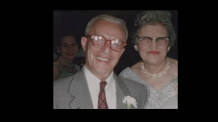 Baltimore, Maryland, USA- 1958: Elderly couple kiss and dance