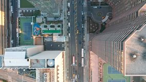 Aerial drone footage of New York skyline along 42nd street canyon with camera uptilt movement.