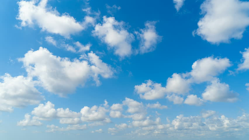 Clear blue sky with white fluffy clouds. Nature background. Time lapse VDO | Shutterstock HD Video #1024380614