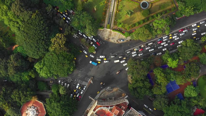 Bangalore city traffic park street crossroad aerial topdown panorama 4k india | Shutterstock HD Video #1024399913