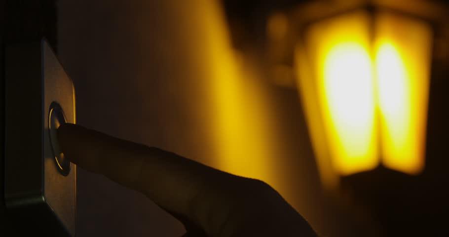 Ringing Doorbell at Night Close Up of Male Finger Pushing Door Bell  | Shutterstock HD Video #1024414265
