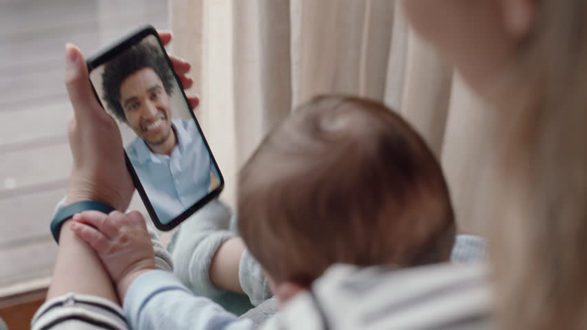 mother and baby having video chat with father using smartphone waving at infant enjoying communicating with family on mobile phone connection Royalty-Free Stock Footage #1024417907