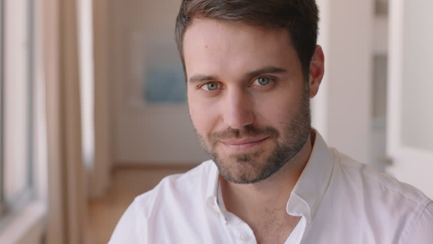Portrait attractive man smiling confident independent male in apartment home | Shutterstock HD Video #1024426637