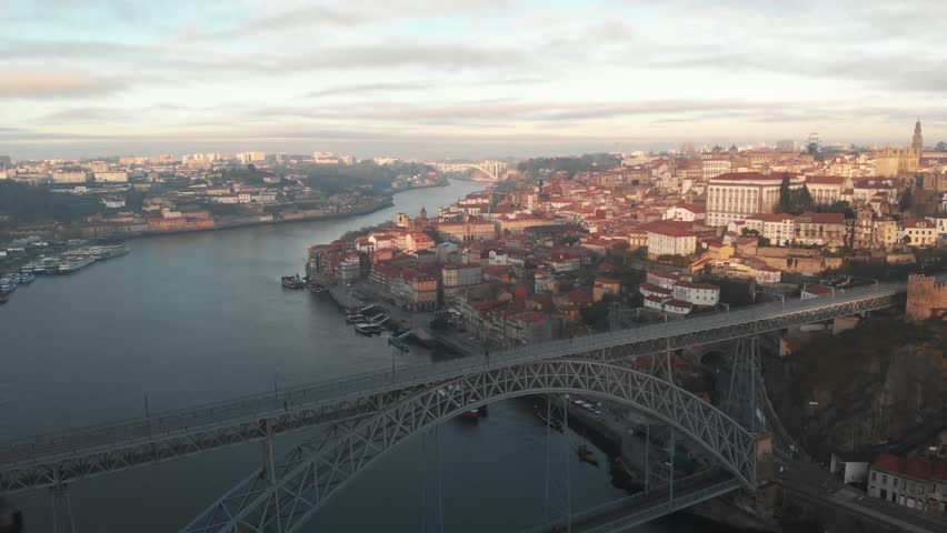 Aerial view of the city of Porto (Portugal), Douro river and Dom Luis I bridge. | Shutterstock HD Video #1024451915