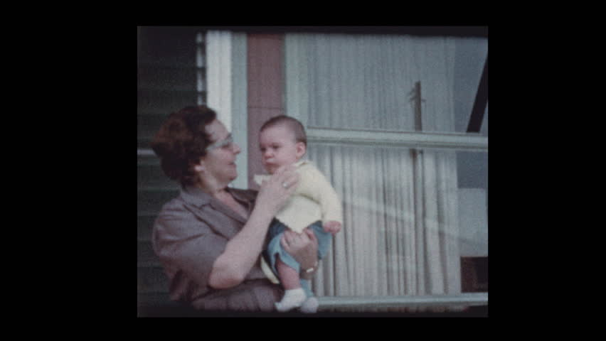 Baltimore, Maryland, USA- 1959: Grandmother meets and holds infant baby boy