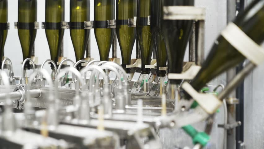 Slow-motion, glass bottles on the automatic conveyor line at the champagne or wine factory. Plant for bottling alcoholic beverages | Shutterstock HD Video #1024484876