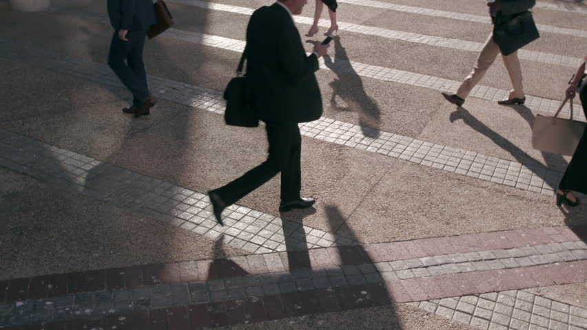 Busy business people commuting to office in the morning carrying office bags and using mobile phones. Commuters being on their phone all the time while commuting.  | Shutterstock HD Video #1024485470