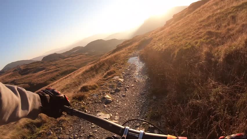Onboard camera: Mountain biking downhill in stone road in Slate Mountain, Great Britain. View from first person perspective POV. 50 fps